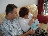 My parents with my little cousin Karol :)